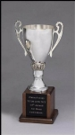 Silver plated trophy cup on solid walnut base is the ultimate in classic achievement trophies.  An elegant presentation product for a distinguished award.  Black aluminum laser engraveable plates included.  Individually boxed.