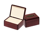 Rosewood piano-finish jewelry box with beige felt lining.  Laser engravable plate for personalization.  Makes a great executive gift!  Individually boxed.