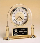 Arch quartz clock suspended in clear acrylic upright with gold-plated solid brass base.  Includes a black & gold brass engravable plate.  Supplied with Lifetime Guaranteed Quartz Movement.  Individually boxed.  *NOTE: Acrylic is not laser engravable.