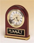 Rosewood piano-finish arched desk clock features a diamond-spun dial, three hand movement and black brass engravable plate.  Supplied with Lifetime Guaranteed Quartz Movement.  Batteries included.  Individually boxed.