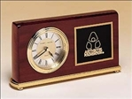 Rosewood piano-finish desk clock features a diamond-spun dial, three hand movement and black brass engravable plate.  Supplied with Lifetime Guaranteed Quartz Movement.  Batteries included.  Individually boxed.