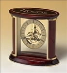 Skeleton clock with sub-second dial, brass-finished movement and rosewood piano-finish accents.  Includes an oval black brass engravable plate.  Supplied with Lifetime Guaranteed Quartz Movement.  Batteries included.  Individually boxed.