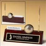 Rosewood piano-finish desk nameplate features a goldtone metal golfball/clock, as well as business card holder and goldtone pen.  Supplied with Lifetime Guaranteed Quartz Movement.  Batteries included.  Individually boxed.