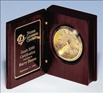 Rosewood stained book clock with gold-spun dial and three hand movement.  Includes a black brass engravable plate.  Supplied with Lifetime Guaranteed Quartz Movement.  Batteries included.  Individually boxed.