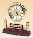 Elegant arch quartz clock suspended with gold-plated solid brass & rosewood piano-finish base.  Includes a black brass engravable plate.  Supplied with Lifetime Guaranteed Quartz Movement.  Individually boxed.
