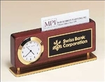 Combination desk clock and business card holder in a rosewood piano-finish base with gold metal accents.  Black brass engravable plate included.  Supplied with Lifetime Guaranteed Quartz Movement.  Batteries included.  Individually boxed.