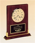 Rosewood piano-finish desktop clock with gold metal accents.  Includes a black brass engravable plate.  Supplied with Lifetime Guaranteed Quartz Movement.  Batteries included.  Individually boxed.
