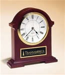 Traditional styling Napoleon quartz clock with deep, hand-rubbed mahogany finish.  Includes a black brass engravable plate.  Supplied with Lifetime Guaranteed Quartz Movement.  Batteries included.  Individually boxed.