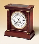 Mantle clock with hand-rubbed mahogany finish, decorative wood inlay & two columns.  Winchester chime movement.  Includes a black brass engravable plate.  Supplied with Lifetime Guaranteed Quartz Movement.  Batteries included.  Individually boxed.
