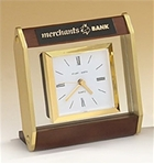 Floating glass clock with square goldtone bezel.  Laser engravable black plate included.  Makes for a wonderful executive gift!  Batteries included.  Individually boxed.