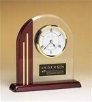 Arch clock with glass upright and rosewood piano-finish post and base.  Includes a black brass engravable plate.  Supplied with Lifetime Guaranteed Quartz Movement.  Batteries included.  Individually boxed.