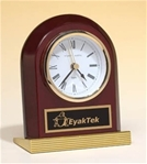 Rosewood piano-finish arched desk clock with gold metal base and black brass engravable plate.  Supplied with Lifetime Guaranteed Quartz Movement.  Batteries included.  Individually boxed.