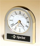 Gold, silver and black plastic arched desk clock with a white dial and alarm movement.  Includes a laser engravable aluminum plate for personalization.  Clock supplied with Lifetime Guaranteed Quartz Movement.  Individually boxed.