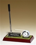 Golf clock and pen desk set on a high gloss rosewood finish base and includes a black brass engravable plate.  Club shaft is a pen.  Supplied with Lifetime Guaranteed Quartz Movement.  Batteries included.  Individually boxed.