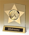 Gold star clock on an acrylic upright with a brushed gold aluminum base.  Includes a black brass engravable plate.  Supplied with Lifetime Guaranteed Quartz Movement.  Batteries included.  Individually boxed.