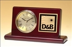 Rosewood piano-finish desk clock features a gold waterfall bezel, three hand movement and diamond-spun dial.  Includes a solid brass engravable plate.  Supplied with Lifetime Guaranteed Quartz Movement.  Batteries included.  Individually boxed.