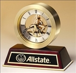 Quartz clock with sub-second dial, brass-finish movement & brushed gold turned aluminum case on rosewood base.  Includes a black brass engravable plate.  Supplied with Lifetime Guaranteed Quartz Movement.  Batteries included.  Individually boxed.