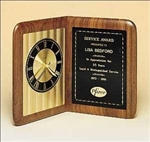 Round quartz clock on free-standing walnut Airflyte edge and decorative black brass engravable plate.  This handsome clock is supplied with Lifetime Guaranteed Quartz Movement.  Individually boxed.