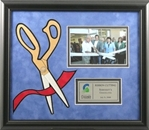 Handsome ribbon-cutting ceremonial frame features a black frame with blue velour background and 3-dimensional die-cut ribbon & scissor graphic.  Includes a printed plate area and 4� x 6� photo slot.