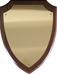 Genuine walnut shield-shaped plaque with brass engraving plate.