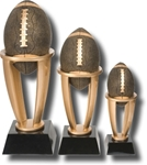 Football Sports Tower Award. The Antiqued BronzeStone Sport Ball is cradled within a four-pronged bright gold-tone tower, set on an ebony tapered base. The engraving plate is marked to acknowledge your top performersl Available in 3 sizes.