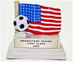 This sculpted ivory-tone US Flag resin soccer trophy is beautifully highlighted with hand-painted USA patriotic color accents. Goldtone personalized plate included. Available while supplies last!